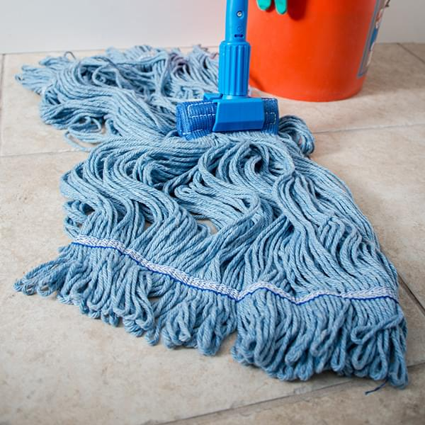 The Carlisle FoodService Flo-Pac® X-Large Blue Band Mop With Looped End