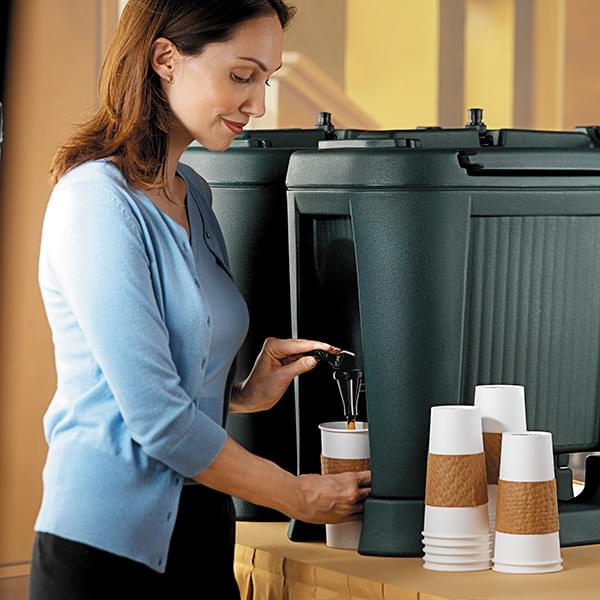The green Carlisle FoodService Slide 'N Seal™ Beverage Dispenser